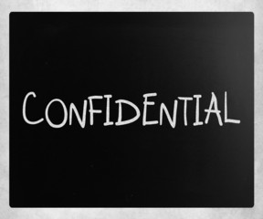 """The word """"Confidential"""" handwritten with white chalk on a blackb"""