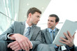 Business meeting in stairs with electronic tablet