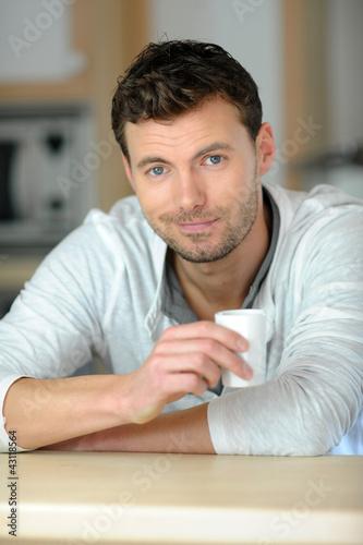 Portrait of handsome guy having coffee