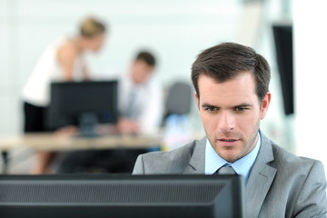 Office worker sitting in front of desktop