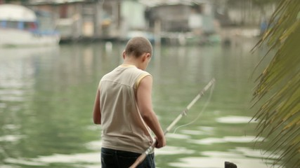 Young people and hobby, boy fishing for fun on lake