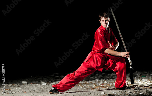 Wushoo man in red practice martial art
