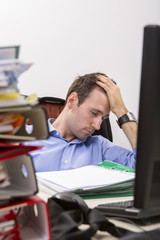 Office worker falls asleep by exhaustion