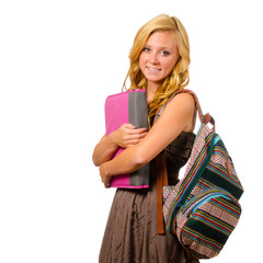 Portrait of happy  teenage schoolgirl with backpack and binder