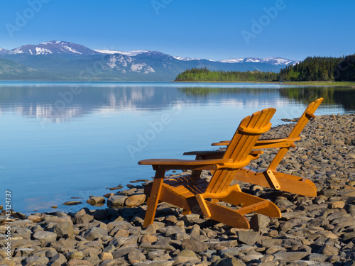 Wooden deckchairs overlooking scenic Lake Laberge