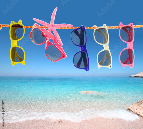 Collection of sunglasses on the beach