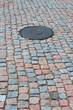 Stone pavement and drain hatch
