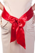 Pregnant Woman's Belly with Red Ribbon