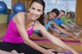 Interracial Group of Middle Aged People Practicing Yoga