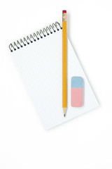 Pencil with eraser and notebook on white background