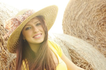 Portrait of beautiful young woman in sun hat