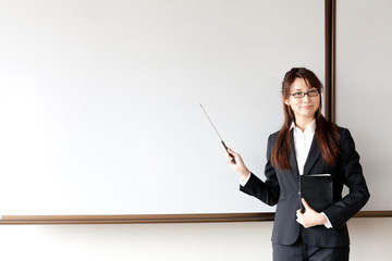 a young businesswoman teaching