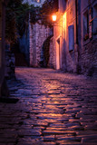 Fototapety Old paved street at night -Pula ,Croatia