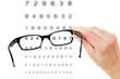 Leinwandbild Motiv Hand holding glasses