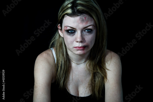 Beaten Woman with bruises and blood