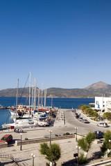 harbor with yachts fishing boats Adamas Milos Greek Island