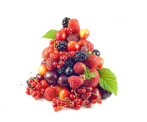 stack of fresh berries and fruit isolated