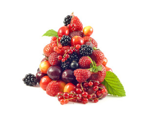 pile of fresh berries and fruit on white background