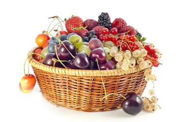 assortment of fresh berries and fruit in basket