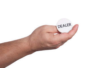 The hand with the dealer button isolated on white