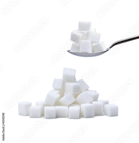 sugar lumps and cubes with spoon