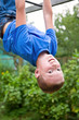 young boy upside down doing gymnastics