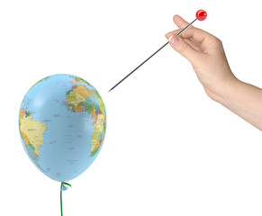 hand with needle aimed at balloon with texture of planet earth
