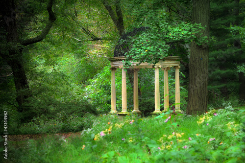 Vintage style garden gazebo in the woods
