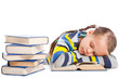 schoolgirl  sleeping over the book on isolated white