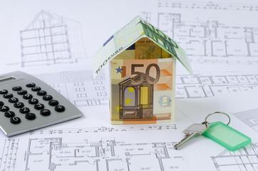 Geld, Haus, Taschenrechner, Baupläne, Schlüssel