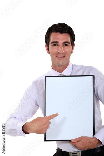 Man holding up a blank bulletin board