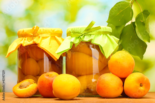 canned apricots in a jars and sweet apricots