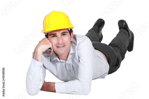 Architect laying on the floor resting