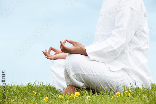 Man sitting in meditative lotus position