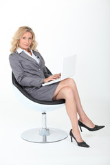 Confident woman sitting in an armchair
