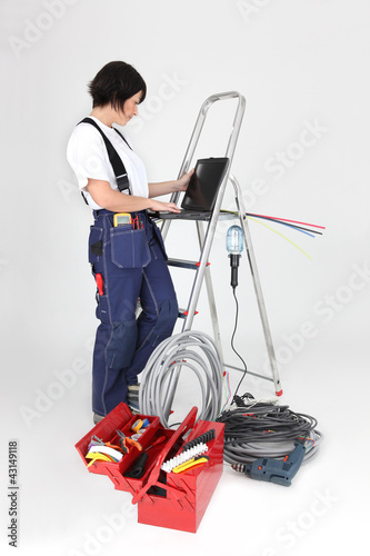 female electrician working on her laptop