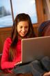 Teenage Girl Relaxing On Sofa With Laptop