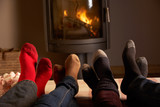 Close Up Of Familys Feet Relaxing By Cosy Log Fire With Marshmal