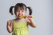 Girl brushing teeth - 43151345