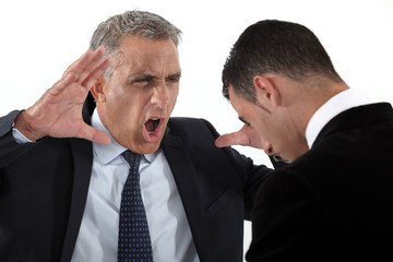 Boss shouting at useless employee