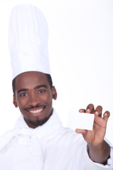 Chef holding up his restaurant's business card