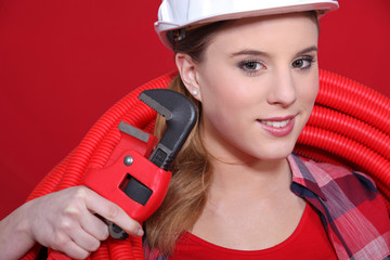 Woman with wrench
