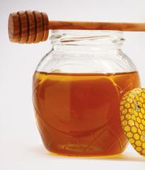 Honey with wood stick