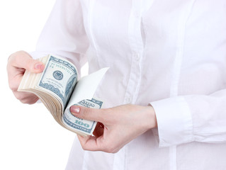 Fake American dollars in a women hands on a white background.