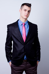 young business man in suit holding