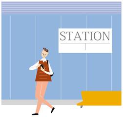 駅でスマホ