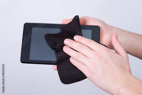 hands cleaning tablet screen