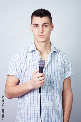 news reporter journalist person holding up the microphone