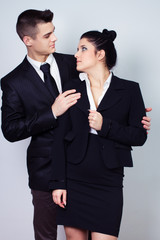 modern young business couple look at each other and posing