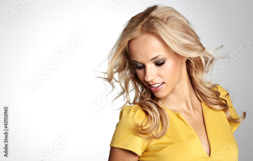woman with beautiful blond hairs and multicolor makeup isolated